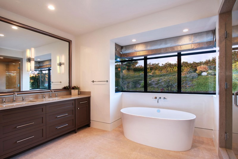 Awesome-Bathroom-in-Galatea-with-White-Tub-Hardwood-Floor-Wooden-Vanity-Brown-Countertop-and-Wide-Mirror
